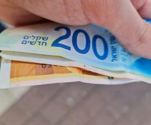שטרות כסף. אילוסטרציה // צילום: אבי וולפסון